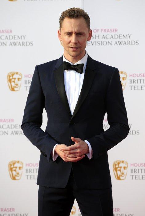 Tom Hiddleston assiste aux BAFTA TV Awards 2016 au Royal Festival Hall à Londres, le 8 mai 2016.