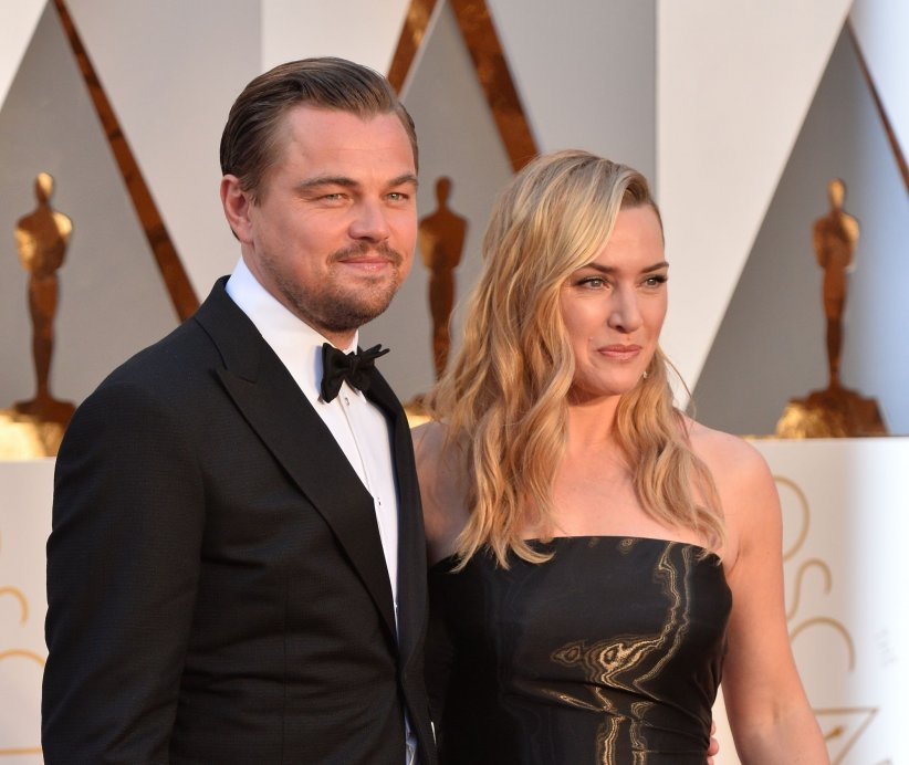 Leonardo DiCaprio (dans un costume à 1 995 dollars) et Kate Winslet (dans une robe Ralph Lauren à 50 000 dollars), lors de la 88e cérémonie des Oscars.