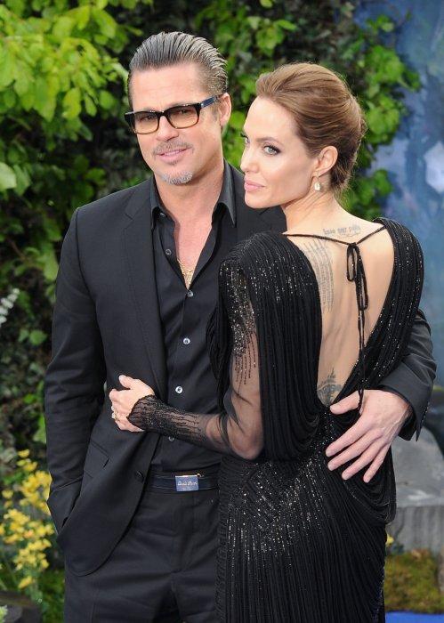 """Angelina Jolie et Brad Pitt lors de la première du film """"Maleficent"""" à Londres, le 8 mai 2014."""