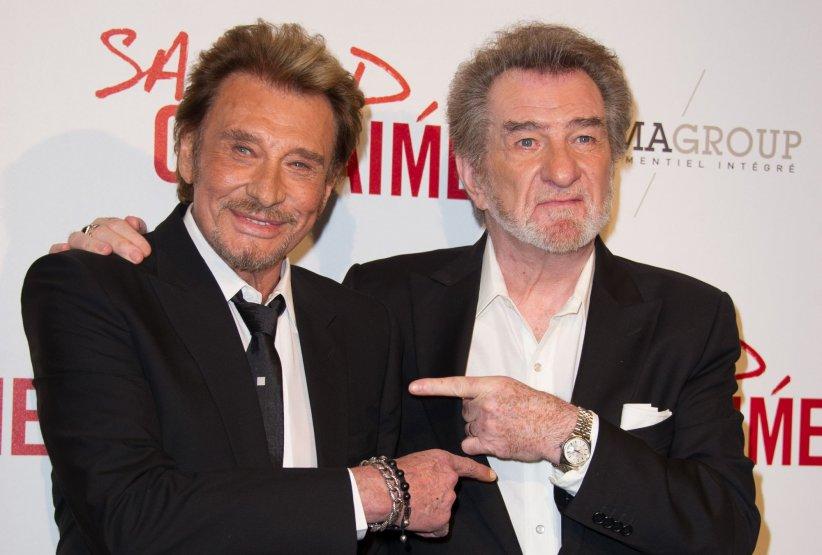 Johnny Hallyday et Eddy Mitchell assistent à la première du film  Salaud on t\