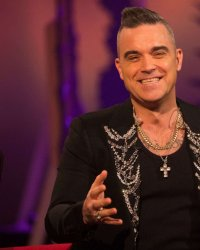 Robbie Williams chante Noël... et la Covid !