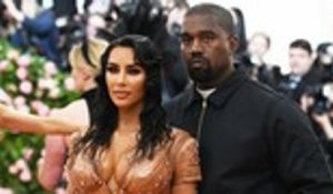 Kim Kardashian and Kanye West Welcome Fourth Child | Billboard News