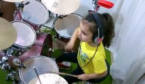 Little girl playing drums on System Of A Down song Toxicity