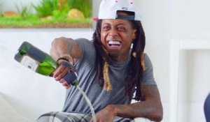 Lil Wayne pours champagne on his new phone!