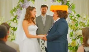 Sexy woman marries funny cheese hat man