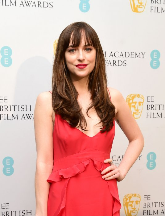 L'actrice Dakota Johnson assiste à l'after de la cérémonie des EE British Academy Awards, à l'hôtel Grosvenor House, à Londres, le 14 février 2016.